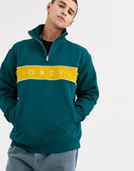 Obey Deal Quarter Zip Sweat With Panel Logo In Teal Brown