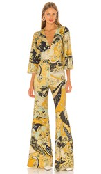 Free People Night Fever Jumpsuit In Yellow. Gold