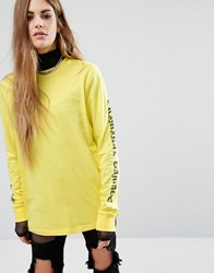 Criminal Damage Oversized Long Sleeve T Shirt With Gothic Arm Text Yellow Black