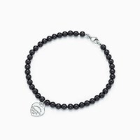 Tiffany And Co. Return To Tiffanytm Mini Heart Tag In Silver On A Black Onyx Bead Bracelet.