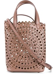 Alaia Laser Cut Bucket Crossbody Bag Nude And Neutrals