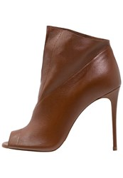 Casadei Tango Ankle Boots Castagna Light Brown