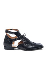 Maison Martin Margiela Maison Margiela Cut Out Leather And Python Oxfords In Black Animal Print