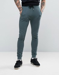 Asos Super Skinny Joggers With Zip Pockets Murky Gold Zips Blue