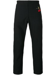 Alexander Mcqueen Swallow Print Tapered Trousers Black