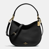 Coach Nomad Crossbody In Glovetanned Leather Light Gold Black
