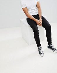 Weekday Cone Slim Tapered Jeans In Stay Black