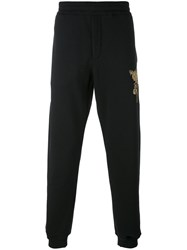 Alexander Mcqueen Embroidered Track Trousers Men Cotton Brass M Black