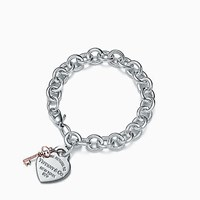 Tiffany And Co. Return To Tiffanytm Heart Tag Key Bracelet In Sterling Silver Rubedo Metal.