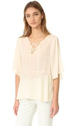 Cupcakes And Cashmere Jocelyn Lace Up Flutter Blouse Ivory