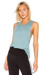 Beyond Yoga Round The Twist Tank In Blue.