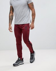 Gym King Logo Skinny Poly Joggers In Burgundy With Side Stripes Red