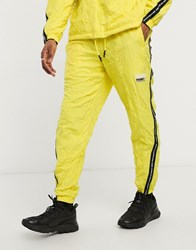 Puma Evide Tape Joggers In Yellow Green
