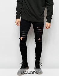 Reclaimed Vintage Super Skinny Jeans With Extreme Distressing Black