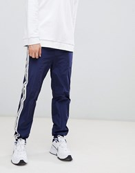 Mennace Joggers With Side Logo In Navy