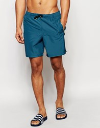 Asos Mid Length Swim Shorts In Blue With Gold Zip Detail Blue