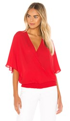 Krisa Smocked Waist Surplice Top In Red. Starlet