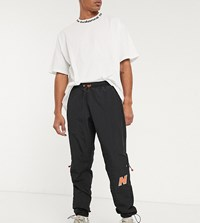 New Balance Utility Pack Utility Woven Logo Sweatpants In Black Exclusive To Asos