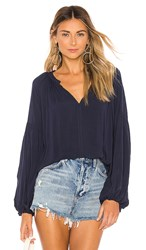 Velvet By Graham And Spencer Elaine Blouse In Blue. Postman