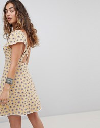 Kiss The Sky Cross Back Button Front Tea Dress In Ditsy Floral Pale Mustard Yellow