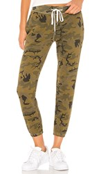 N Philanthropy Night Jogger In Green. Olive Camo