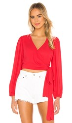 Krisa Wrap Long Sleeve Blouse In Coral. Flirt