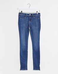Hollister Mid Rise Skinny Jeans In Mid Blue Wash