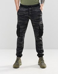 Asos Slim Joggers In Camo With Cargo Styling Blue