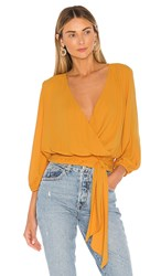 Krisa Tie Side Surplice Top In Yellow. Marigold