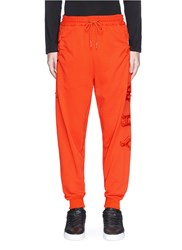 Feng Chen Wang 'Why' Padded Applique Drawstring Pocket Sweatpants Orange