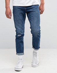 New Look Slim Tapered Jeans In Mid Wash Blue Blue
