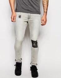 Asos Super Skinny Jeans With Printed Knee Grey