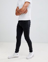 Bershka Super Skinny Jeans In Washed Black