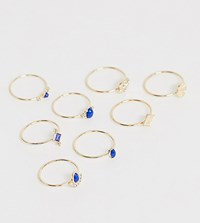 Asos Design Curve Pack Of 8 Rings With Engraved Coin Details And Blue Stones In Gold Tone Gold