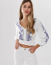 Parisian Cropped Wrap Front Embroidered Blouse With Peplum Hem White