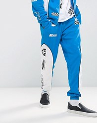 Jaded London Skinny Joggers In Blue With Racing Print