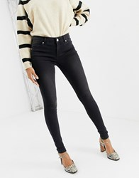 Oasis Mid Rise Skinny Jeans In Washed Black Wash