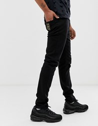Emporio Armani J06 Stretch Slim Fit Jeans With Gold Logo In Black