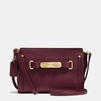 Coach Swagger Wristlet In Pebble Leather Light Gold Burgundy