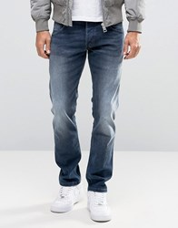 Wrangler Low Rise Slim Leg Jean In Fuzzy Duck Wash Blue