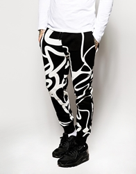 Criminal Damage Joggers In Jigsaw Print Black