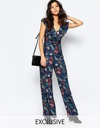 Reclaimed Vintage Wide Leg Jumpsuit With Ruffles And Lace Up In Floral Navy