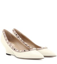 Valentino Garavani Rockstud Patent Leather Wedge Pumps White