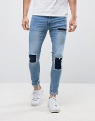 New Look Super Skinny Jeans With Patch Detail In Mid Wash Blue Blue