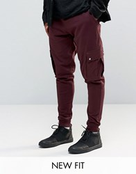Asos Tapered Joggers With Cargo Pockets In Burgundy Oxblood