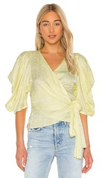 Krisa Puff Sleeve Wrap Top In Yellow. Daisy