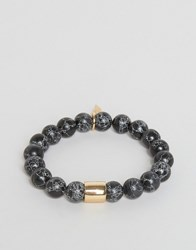 Chained And Able Gold Hanging Wing Beaded Bracelet In Marble Effect Black