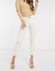 River Island Molly Mid Rise Chewed Hem Skinny Jeans In Ecru White