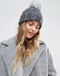 Helene Berman Cable Knit Beanie Hat With Faux Fur Pom Pom Grey