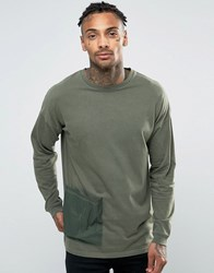 Asos Oversized Longline Long Sleeve T Shirt With Nylon Pocket And Back Tape Khaki Green